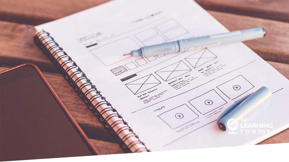 A notepad with UX design sketches
